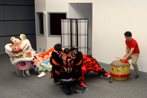 Team members practice the lion dance in the ICC Auditorium.